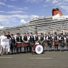 Pipe band & new maps with backdrop of Queen Elizabeth