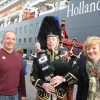 Passengers get pictures with the piper